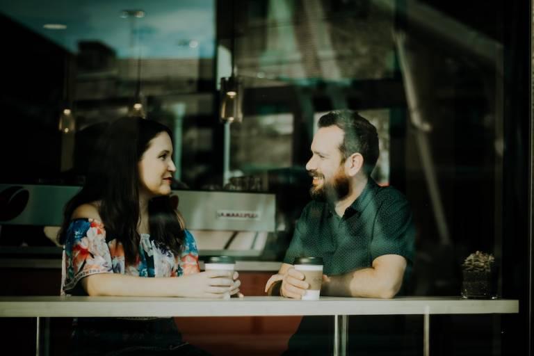 Couple sitting down having coffee