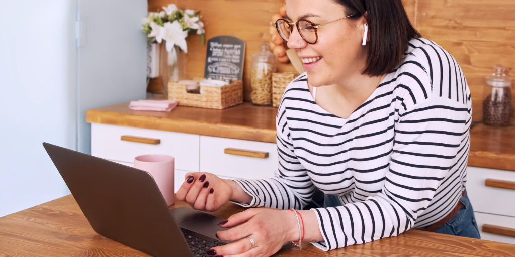 Woman engages with customer service queries at home on laptop.