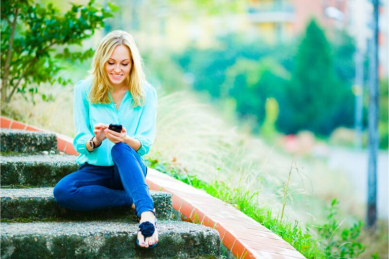 Woman steps with phone