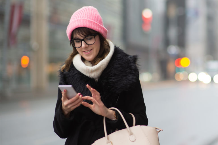 Woman uses her mobile device.